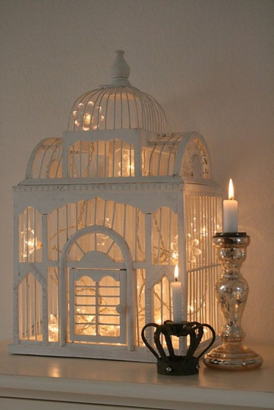 bird cage lighting. as a part of your holiday decor stuff some christmas lights into cage and light bird lighting