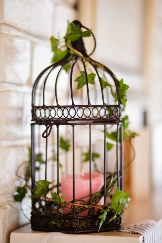 A little bird cage is an interesting alternative to a candle lantern.