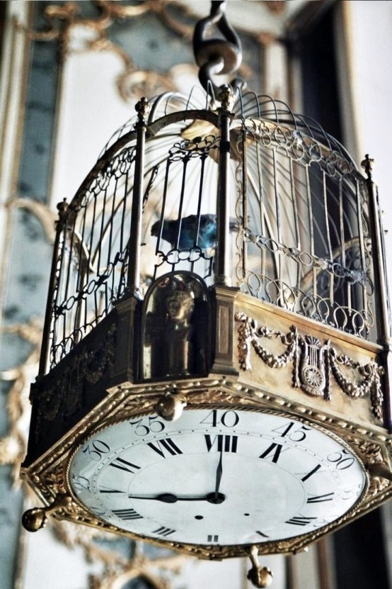 You could mount a clock mechanism on the bottom of a cage and hang it high. It'd be much cooler idea than a simple wall clock.