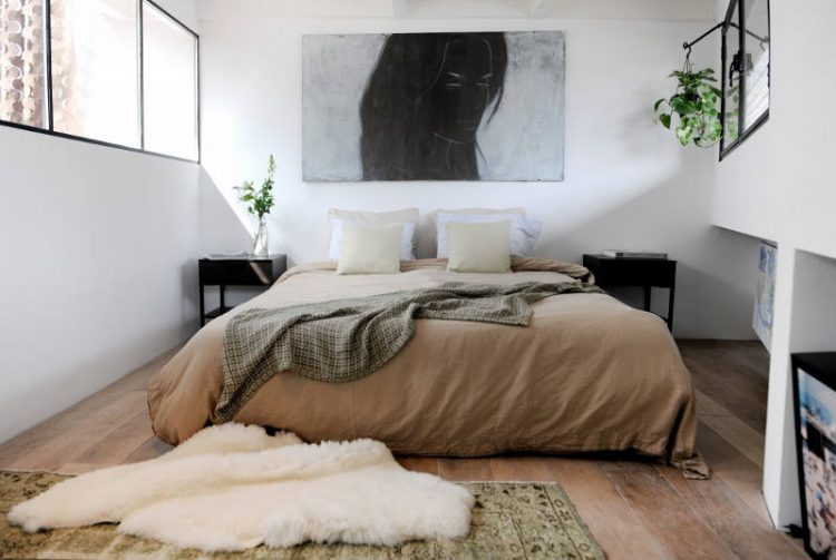 The bedroom is a bachelor one but not too masculine, decorated in earthy tones