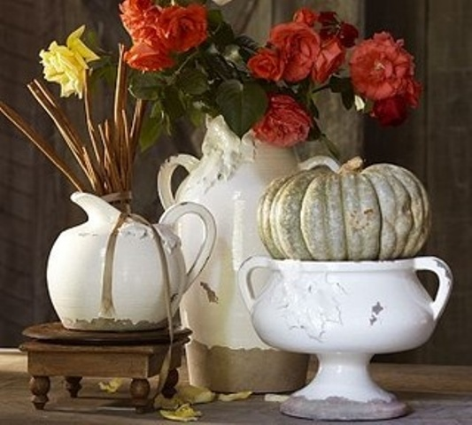 sweet vintage Thanksgiving decor of white porcelain, a green pumpkin, bright blooms and greenery is ideal for Thanksgiving