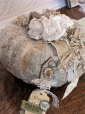 a vintage decoupage pumpkin with ribbons and brooches, some lace and buttons is a pretty Thanksgiving decoration to make