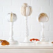 white stands with neutral fabric pumpkins are ideal for Thanksgiving, make some yourself