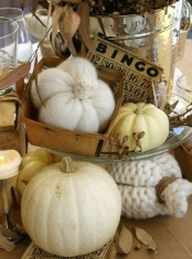 vintage rustic Thanksgiving decor – knit and crochet pumpkins and neutral ones, candles and dried leaves look very decadent