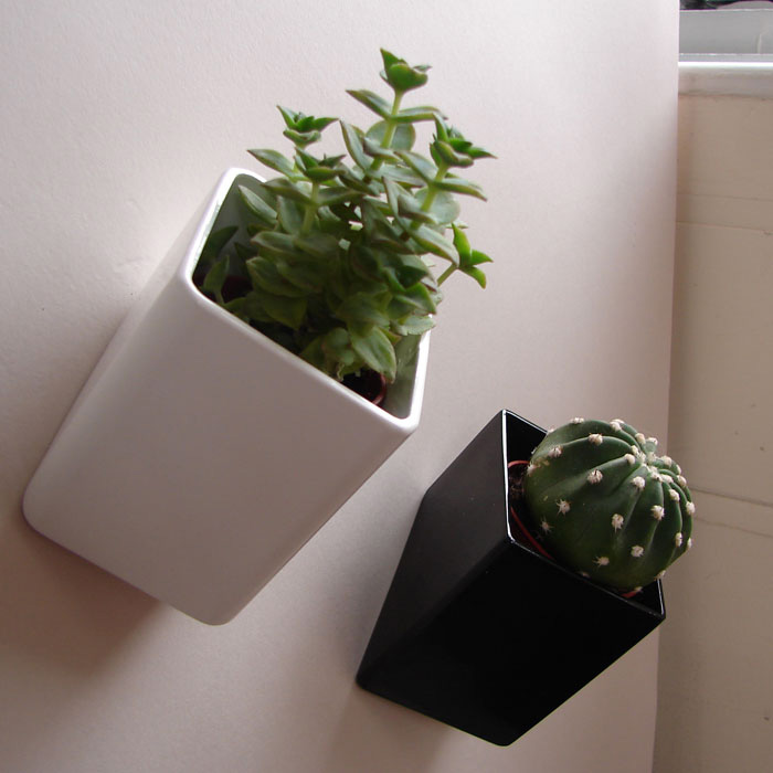 wall mounted flower pots off the wall by thelermont hupton digsdigs. Black Bedroom Furniture Sets. Home Design Ideas
