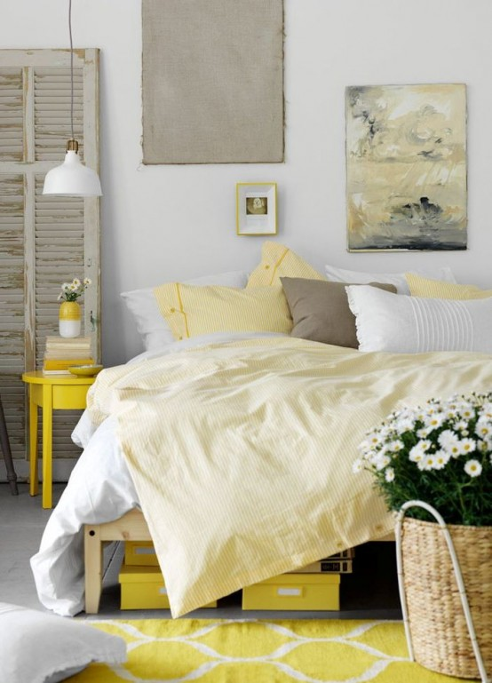 a bright and chic bedroom with a white IKEA Ranarp lamp and rough artworks and shutters that add a rough touch to the space