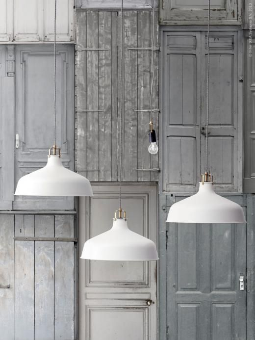a cluster of white Ranarp pendant lamps can be used in any space, whether it's an entryway or a kitchen