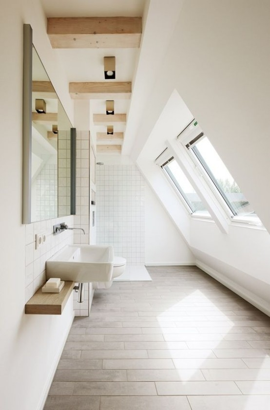 a modern white bathroom with windows, a floating vanity, a large mirror and wooden beams on the ceiling