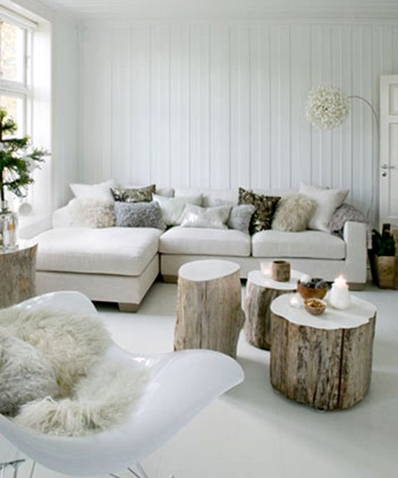 a variety of fluffy pillows make the living room very cozy and holiday like