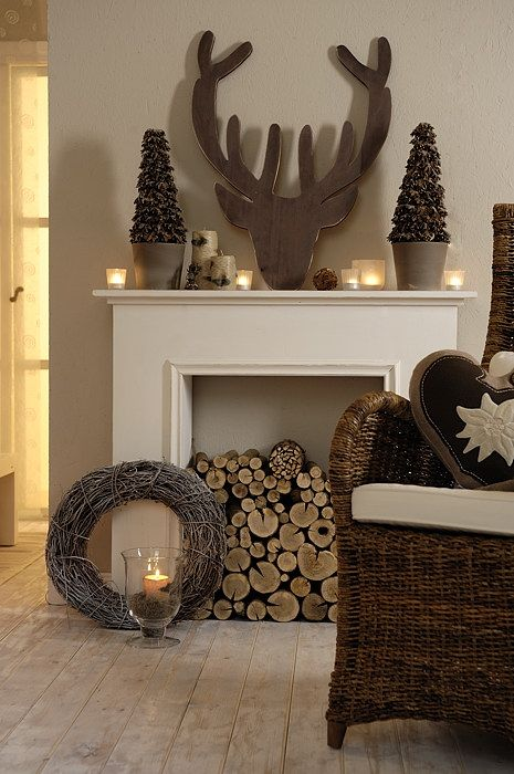 a non-working fireplace can be filled with firewood to make it cozier and you can style the mantel in some cute way, too