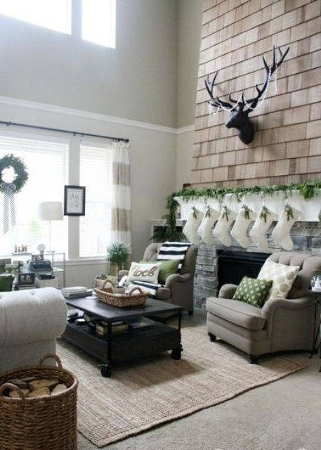 lots of fresh greenery in decor, firewood in a basket and some green elements to echo with the greenery refresh the space
