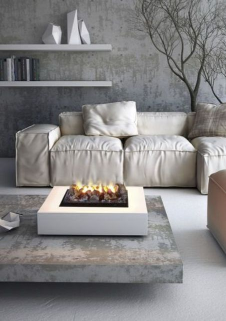 a modern portable mini fireplace with pebbles will instantly cozy up the living room and any other room where you place it