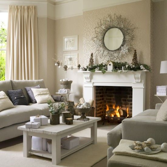 spruce up your living room with greenery decor, tree stumps as holders and candleholders and pinecones
