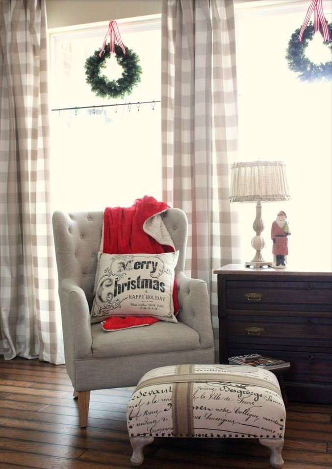 cozy plaid curtains, a red blanket and some pillows make the living room holiday ready and very welcoming