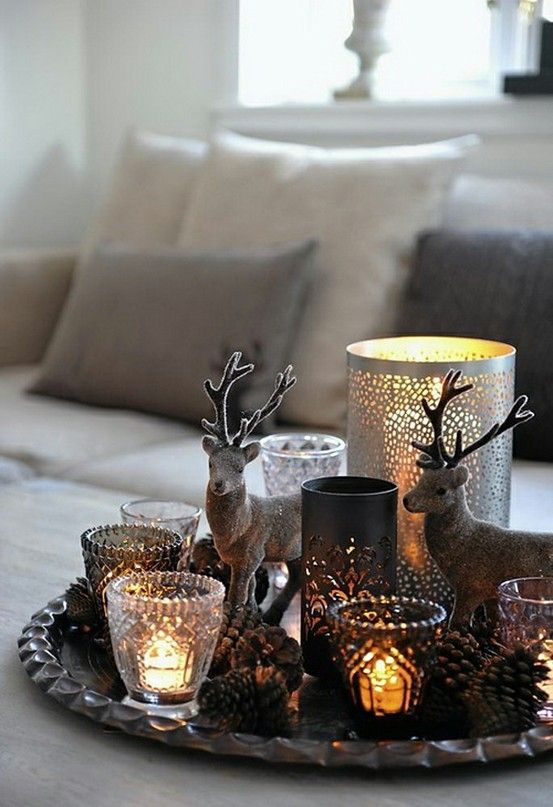 candles in various candleholders on a tray cozy up the space and make the living room more welcoming