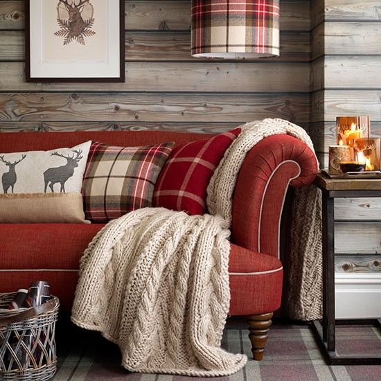 plaid pillows and a knit blanket make the living room cozy and cool, it feels holiday-like