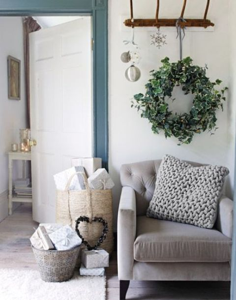 a fresh greenery wreath will make your living room fele more like outdoors and will refresh the space for the holidays