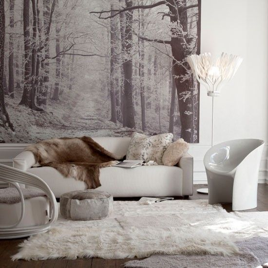 rugs, faux fur furniture and blankets plus pillows make the living room winter-ready and very welcoming