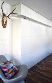 Tall white IKEA Besta storage system