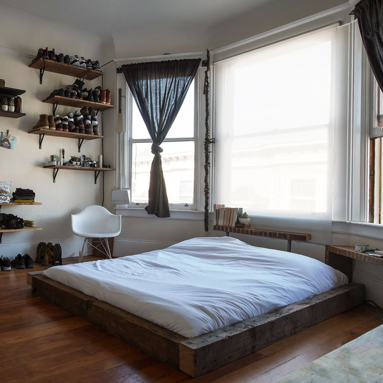 Well organized masculine bedroom combined with a closet On the floor bed frames