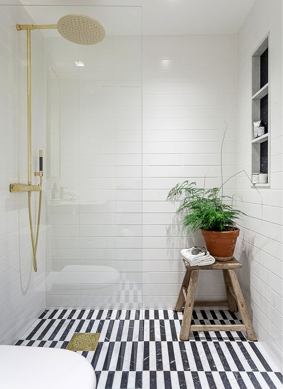 white bathroom design with a black and white floor