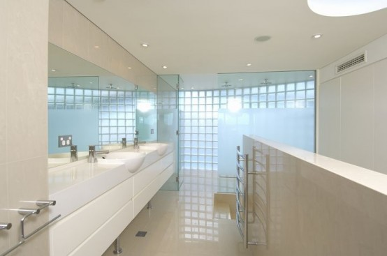 white bathroom seafront house