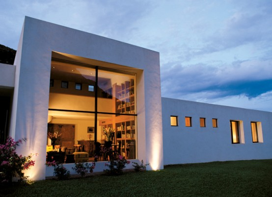 White Concrete House Surrounded By Greens And Blues Of Nature