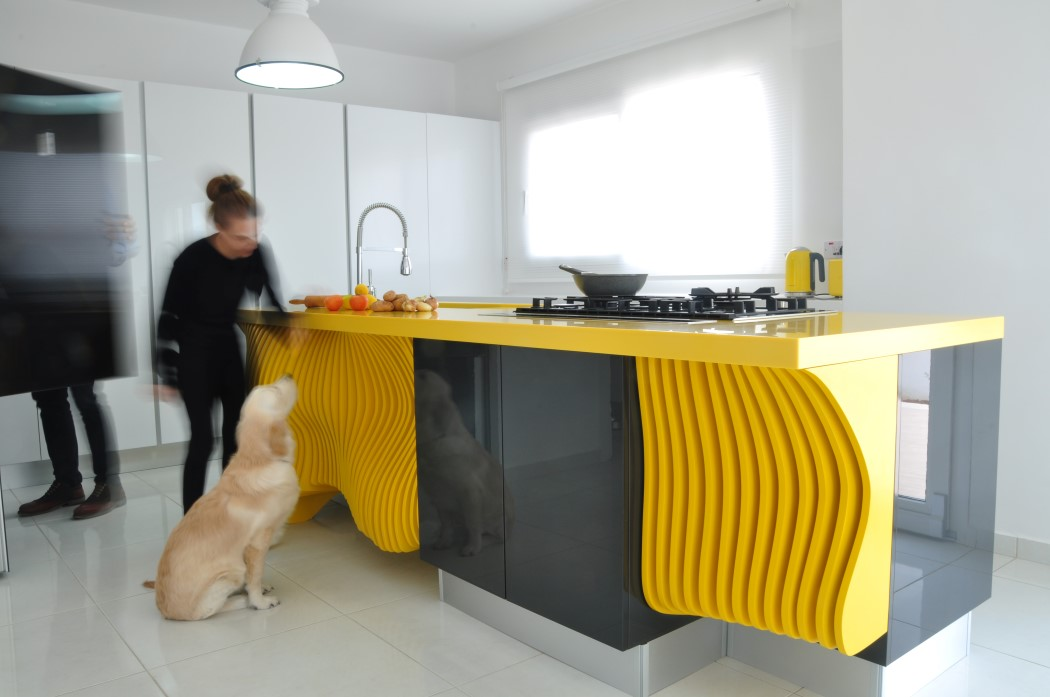 Picture Of white minimalist kitchen with a sculptural yellow island  2