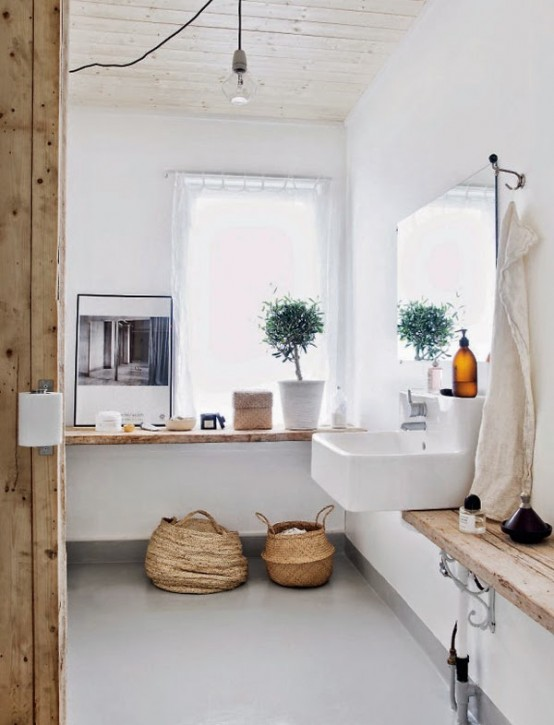 White Scandinavian Apartment With Natural Wood Accents