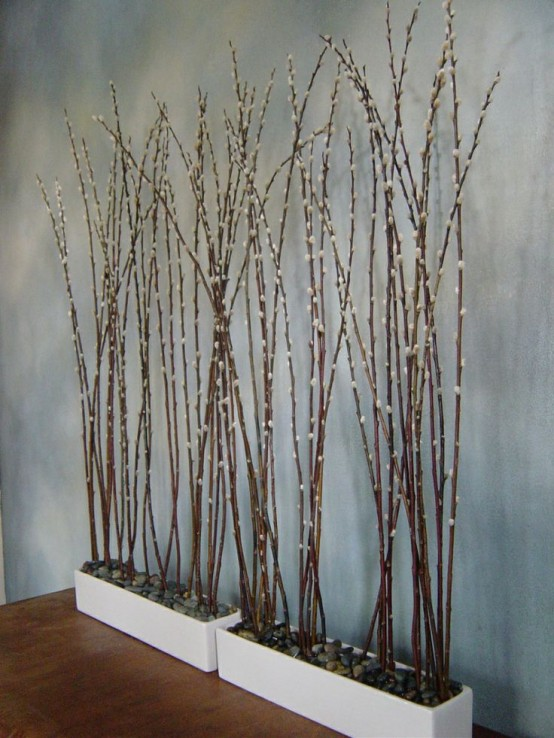 white planters with pebbles and tall willow are a cool decoration for spring - indoor or outdoor