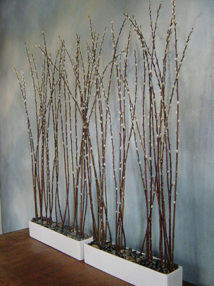 white planters with pebbles and tall willow are a cool decoration for spring   indoor or outdoor
