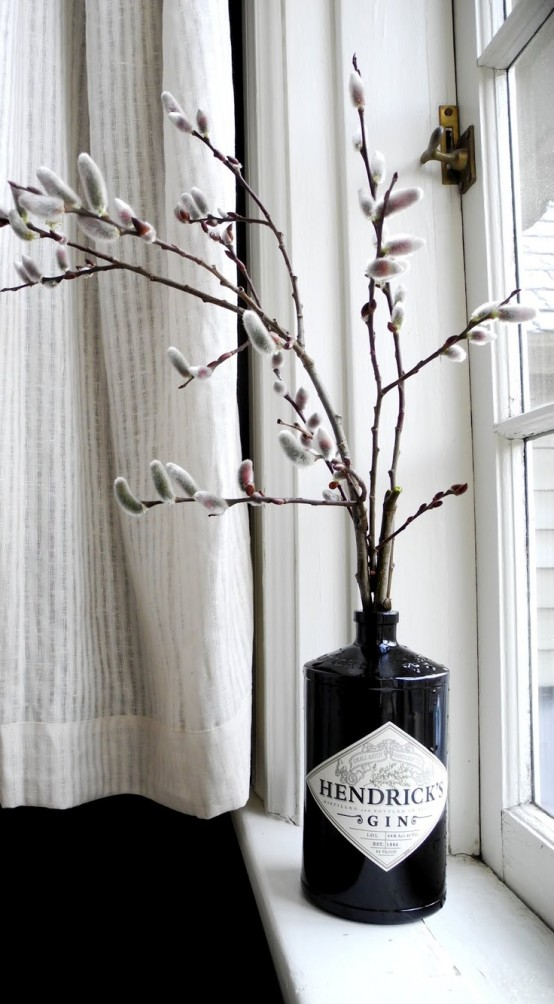 a black alcohol bottle with willow is a bold modern decoration to rock in spring