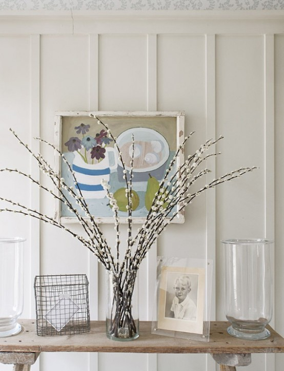 a clear glass vase with willow can be placed anywhere in your home to bring a spring and Easter feel