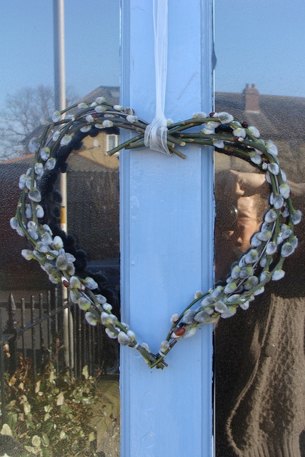 a willow heart-shaped wreath is a nice front door decoration for spring, Valentine's Day and Easter
