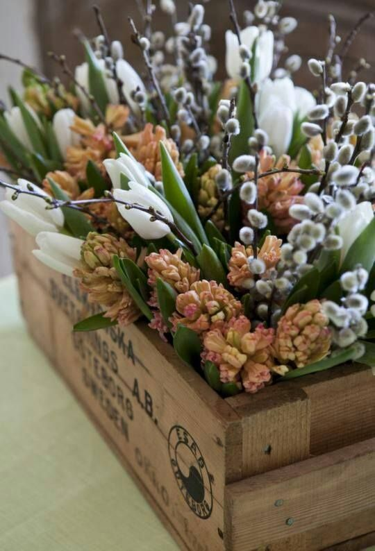 a wooden crate with white tulips, dried blooms, willow is a ncie rustic spring or Easter centerpiece