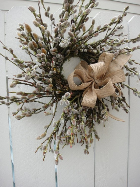a spring wreath made of willow and accented with a burlap bow will bring a strong rustic spring feel to your porch