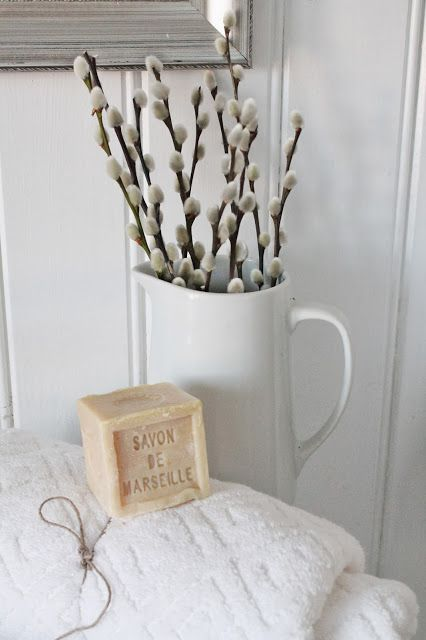 a white jug with willow is a simpel and natural decoration for any space - from a bathroom to a bedroom