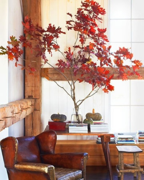 branches with bright red fall leaves and a couple of natural pumpkins will add a natural fall touch to the space