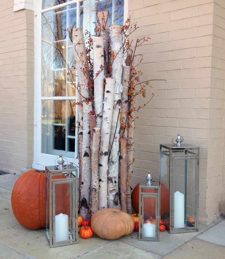 a branch arrangement with berries, pumpkins and candle lanterns plus little faux pumpkins will be ideal both inside and outside this fall