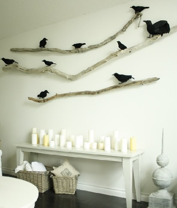 branches attached to the wall and black faux birds on them is a stylish Halloween decoration