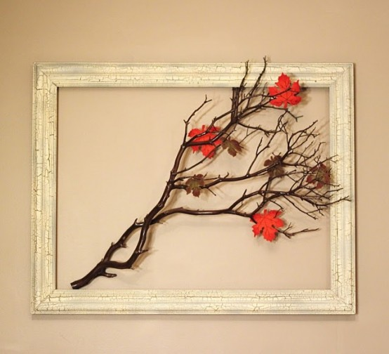 a fall artwork of an empty frame with branches and bright leaves is a cool idea