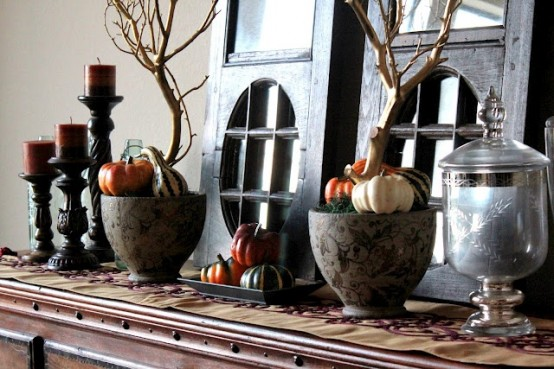 patterned porcelain bowls with moss, faux veggies and branches plus faux pumpkins and bold candles for mantel decor