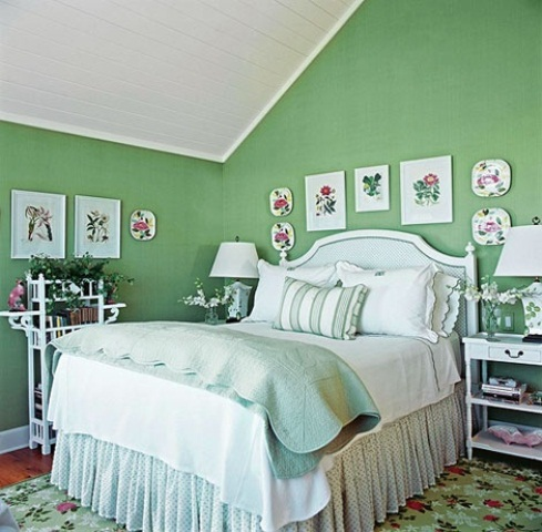 floral and botanical print plates and bright bedding and potted blooms make the space feel spring-inspired