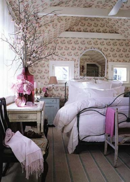 floral wallpaper, pink bedding and blooming branches refresh the bedroom for spring