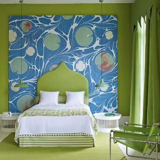 bright greens and a bold statement artwork on the wall make the bedroom look and feel bright
