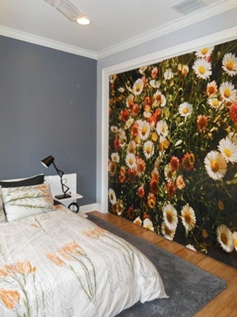 a floral statement wall and botanical bedding for a spring feel in the bedroom and a fresh touch
