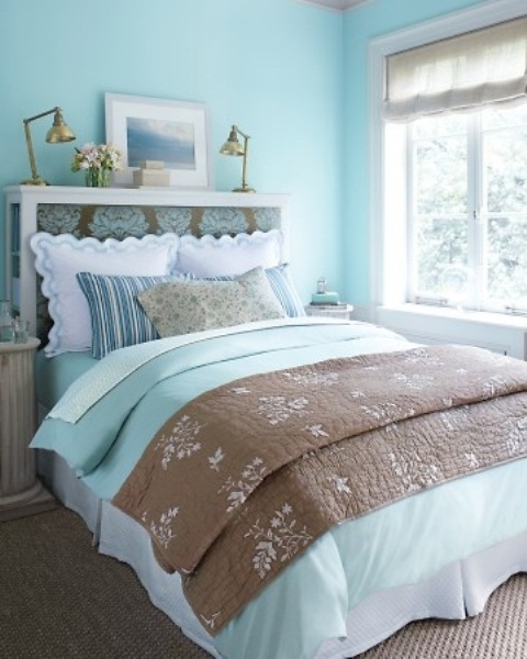 bright and fresh blues in the ddecor echo int he bedding, too, and make the bedroom look fresh