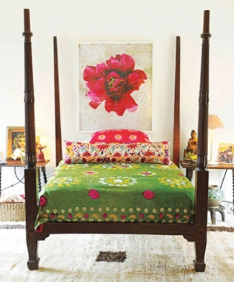 bright bedding and a colorful artwork make the bedroom feel fresh, bright and spring-like