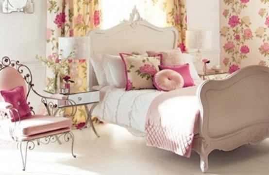 a neutral bedroom with floral curtains and bright bedding and touches of pink make the space feel like spring
