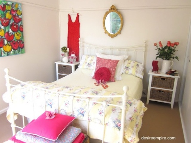 bright red and pink touches and a floral artwork make the bedroom feel like spring, bold and fresh